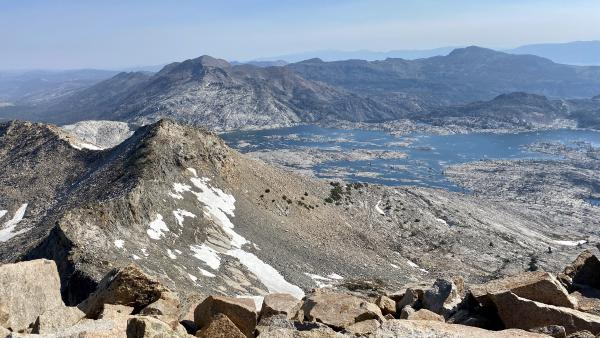A view from the summit of Pyramid Peak, with Agassiz and Price in the foreground and Lake Aloha in the distance