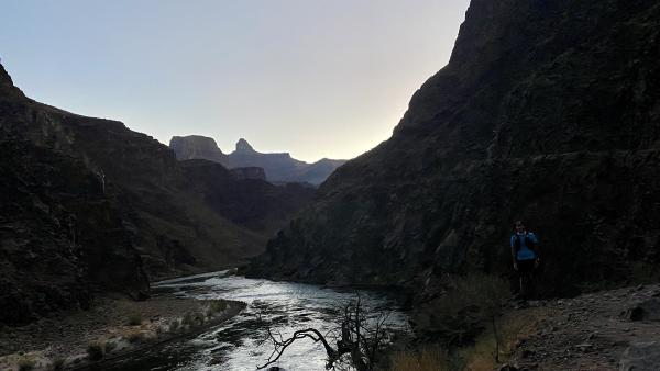 A picture of Chris alongisde the Colorado River in the early morning light