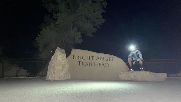 Chris crouches near the Bright Angel Trail trailhead