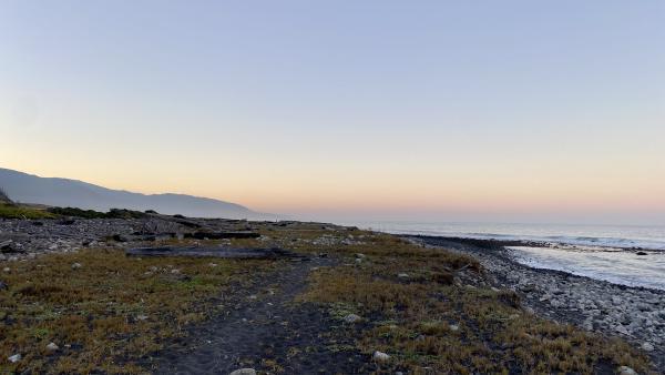 A colorful sunset sky over a remote coast