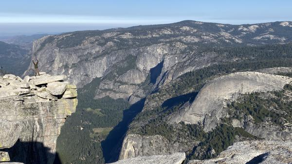 Chris on Half Dome, with the Yosemite Valley in the background