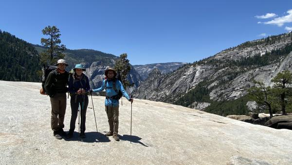 Chris, Katie, and Bobby smile from the top of Nevada Fall